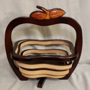 Unique wood carved accordion basket